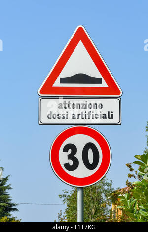 LAKE GARDA, ITALY - SEPTEMBER 2018: Road sign in the town of Garda on Lake Garda warning drivers of speed bumps and the speed limit. - Stock Photo