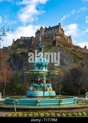 Ross Fountain in original colours after 2018 renovation with Edinburgh Castle to rear in Princes Street Gardens, Edinburgh, Scotland ,UK