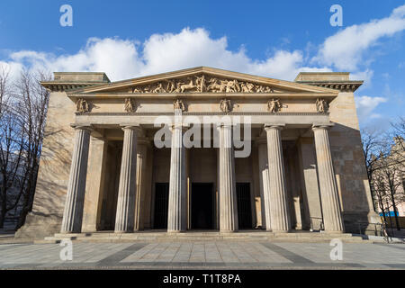 Neo-Classical facade of the Neue Wache, war memorial for the victims of war and dictatorship in Berlin, Germany, on a sunny day. - Stock Photo