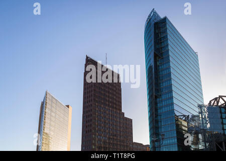 Modern high-rise buildings against clear blue sky at Potsdamer Platz in downtown Berlin, Germany, on a sunny day. - Stock Photo