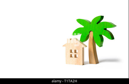 Wooden palm tree and hut on an isolated background. Conceptual leisure and vacation. Rental homes and properties in the resort. Romantic travel. Enter - Stock Photo