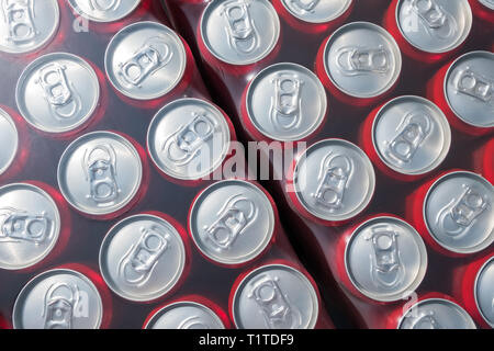 Red  aluminium cans packed in plastick background, view from the top - Stock Photo