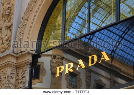 Milan / Italy Mar 09 2019: Sign of Prada fashion on store with reflection of glass roof of the Galleria Vittorio Emanuele II in window - Stock Photo
