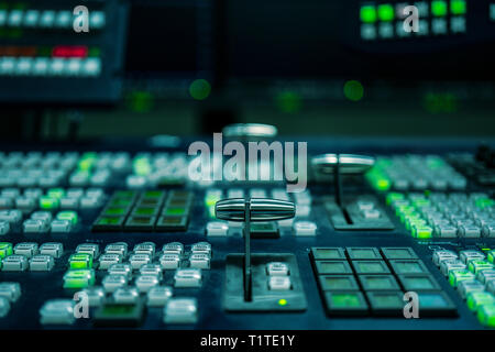 Controlled in a broadcast studio - Stock Photo
