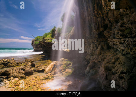 Jogan waterfall in special region of Yogyakarta end up in the sea - Stock Photo