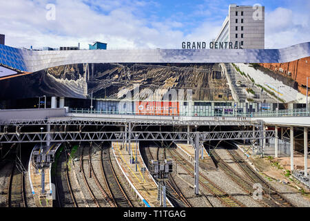 View over the wall looking onto the new Grand Central shopping centre above the railway lines at Birmingham New Street station - Stock Photo