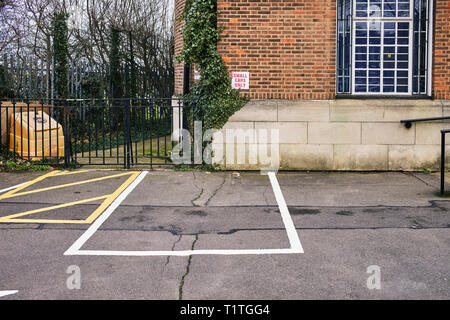 Small cars only parking space outside East Finchley library building - Stock Photo