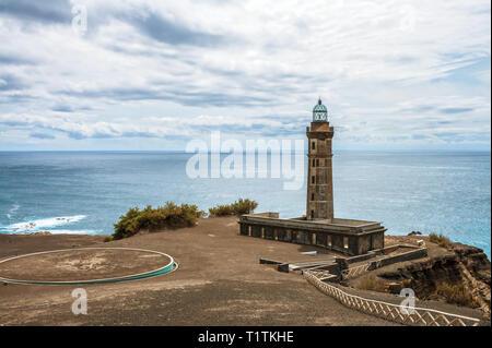 Old Capelinhos Lighthouse on the Atlantic Ocean, Faial Island, Azores - Stock Photo