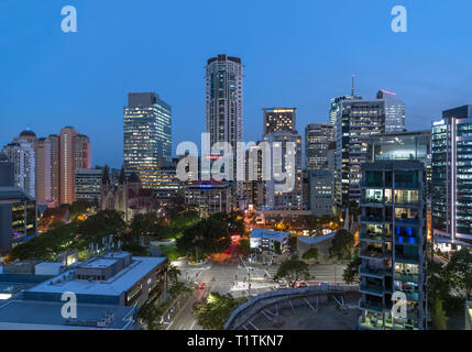 The skyline of the Central Business District (CBD) at night looking towards Cathedral Square, Brisbane, Queensland, Australia - Stock Photo