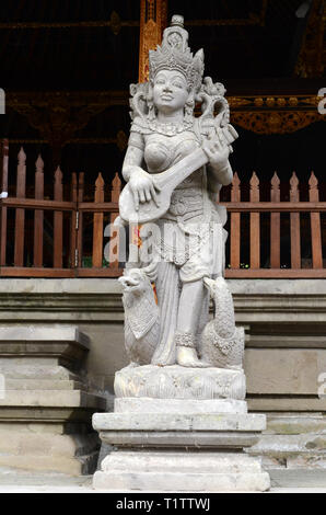 Closeup portrait of stone traditional sculpture art form incorporated into temples in Bali, Indonesia - Stock Photo