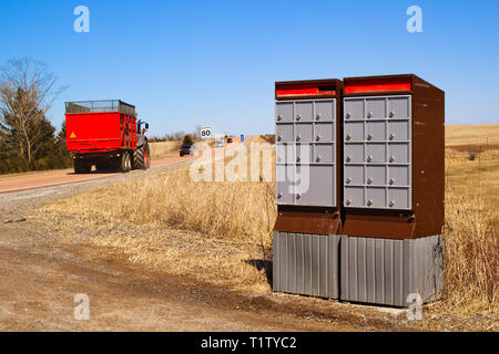 Community mailboxes beside rural highway. - Stock Photo