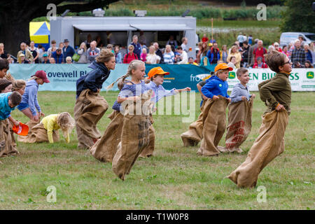 The childrens sack race in the main arena of the 2018 Aylsham Agricultural Show, Norfolk, UK. - Stock Photo