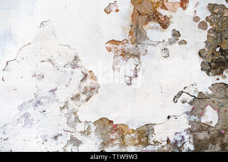 Old plastered brick wall with damaged plaster - Stock Photo