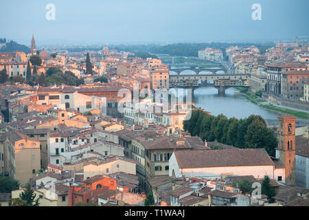 Elevated view over Florence towards the ponte Vecchio across the river Arno from the Piazzale Michelangelo viewpoint at sunrise. - Stock Photo