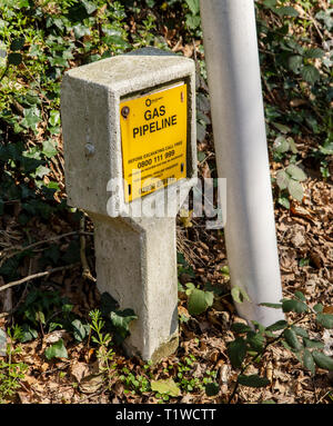 Gas pipeline sign by the roadside, Trow Hill, Sidmouth, Devon, UK - Stock Photo