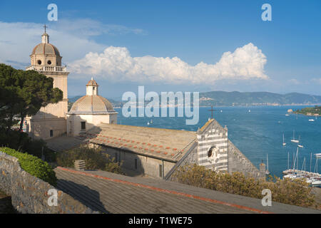 Colorful picturesque harbour of Porto Venere with San Lorenzo church, Doria Castle and Gothic Church of St. Peter, Italian Riviera, Liguria, Italy. - Stock Photo