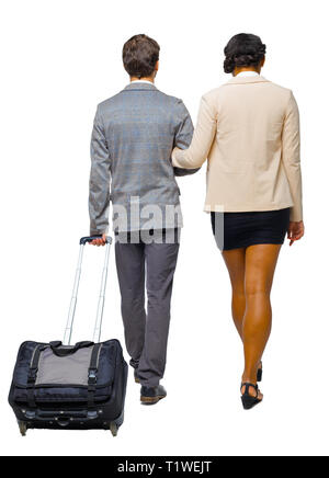 Back view of interracial going couple with suitcase. Rear view people collection. backside view of person. Isolated over white background. A couple of - Stock Photo