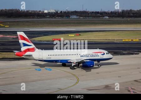 07.02.2019, Duesseldorf, North Rhine-Westphalia, Germany - British Airways aircraft on its way to the runway, Duesseldorf International Airport, DUS.  - Stock Photo
