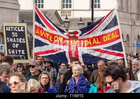Whitehall, London, UK; 23rd March 2019; Protesters March With  Union Jack Flag  During the anti-Brexit 'Put it to the People' March in Central London - Stock Photo