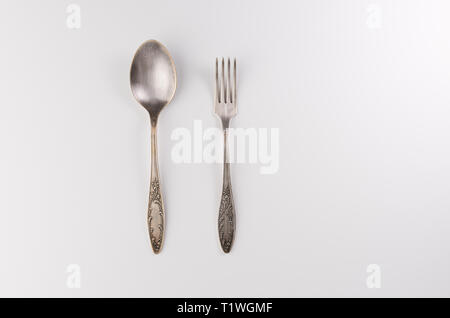 Vintage fork and spoon isolated on white background - Stock Photo
