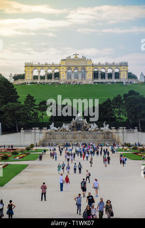 Vienna, Austria, September , 15, 2019 - View of tourists on Gloriette structure and Neptune fountain in Schonbrunn Palace   - Stock Photo
