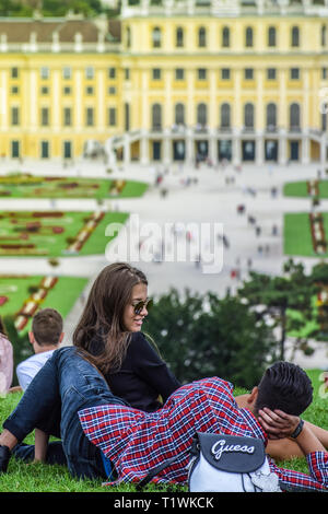 Vienna, Austria, September , 15, 2019 - Couple talking, dating and kissing at the hill in front of Schonbrunn Palace , a former imperial summer - Stock Photo