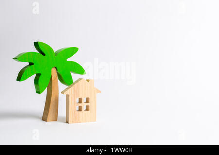 Wooden palm tree and hut on a white background. Conceptual leisure and vacation. Rental homes and properties in the resort. Romantic travel. Entertain - Stock Photo
