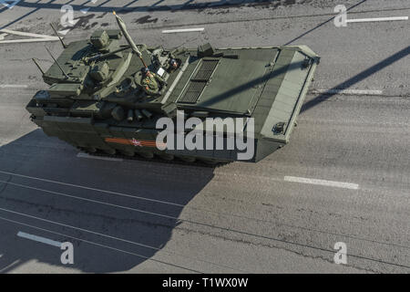 May 9, 2015. Heavy infantry fighting vehicle T-15 Armata returns from Red Square after the Victory Parade, top-back view. - Stock Photo