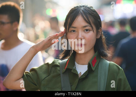 Chinese girl in PLA (People's Liberation Army) uniform from 60's/70's in Xi'An, Shaaxi, China - Stock Photo