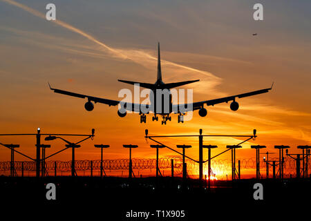 G-CIVE British Airways Boeing 747-400 airliner landing at Heathrow airport at sunset - Stock Photo