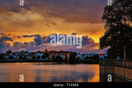 Colorful sunset with dramatic clouds over the Schwerin old town. Mecklenburg-Vorpommern, Pomerania, Germany - Stock Photo