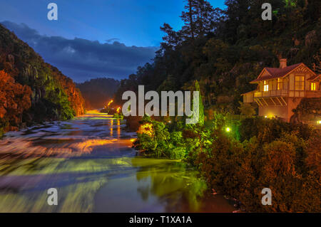 Colourful twilight image combining artificial lighting and dusk, of the artists in residence property on the Tamar River in Launceston, Tasmania. - Stock Photo