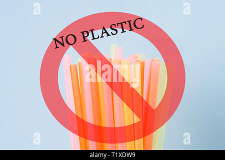 Abstract a colorful of plastic straws used for drinking water or soft drinks. concept of protest and the words No Plastic. - Stock Photo