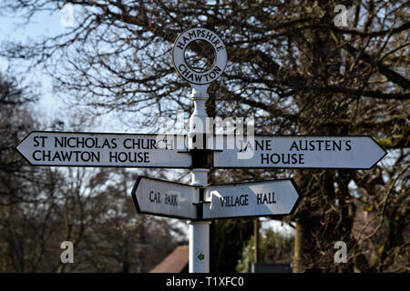 Direction signs in the village of Chawton, near Alton, Hampshire, UK. - Stock Photo