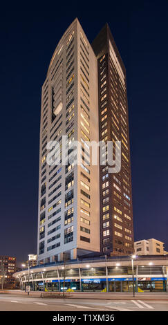 The 96-meter Regent residential tower at night, completed in 1999. It was the pioneer for high-rise buildings in the city. - Stock Photo