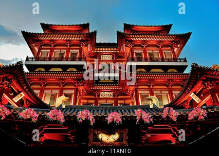 Exterior of Buddha Tooth Relic Temple in Chinatown, Singapore at evening blue hour and lit for Chinese New Year