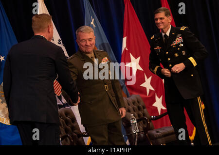 U.S. Acting Secretary of Defense Patrick M. Shanahan shakes hands with the new commander of U.S. Central Command, U.S. Marine Corps Gen. Kenneth F. McKenzie Jr., at the Centcom change of command, Tampa, Florida, March 28, 2019. The outgoing Centcom commander, U.S. Army Gen. Joseph L. Votel, is on the right. (DoD photo by Lisa Ferdinando) - Stock Photo