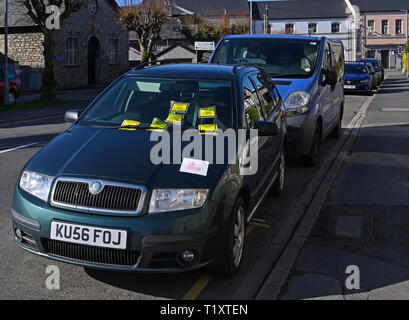 Illegally parked car on yellow line with six penalty charge notices. Parkside Road, Kendal, Cumbria, England, United Kingdom, Europe. - Stock Photo