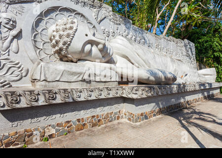 Reclining buddha statue at the Long Son Pagoda or Chua Long Son, a Buddhist temple in the city of Nha Trang in south Vietnam - Stock Photo