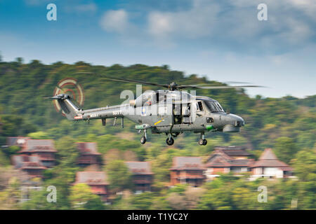 LANGKAWI, MALAYSIA : MARCH 28, 2019 : Malaysian Navy Super Lynx helicopter en route to a staged rescue operation at the LIMA exhibition Credit: Chung Jin Mac/Alamy Live News - Stock Photo