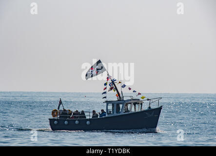 Mousehole, Cornwall, UK. 29th Mar, 2019. UK Weather. The first trip boat of the season bringing people back to Mousehole. Credit: Simon Maycock/Alamy Live News - Stock Photo
