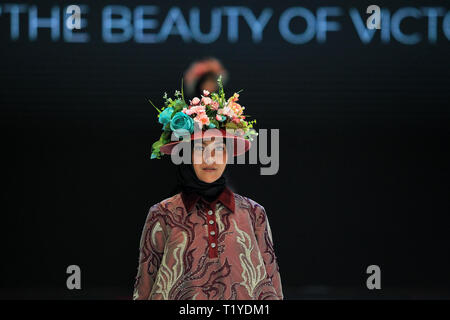 """Jakarta, Indonesia. 29th Mar, 2019. A Model showcases designs L-Two """" The Beauty Of Victorian"""" on the runway by Linda during Indonesia Fashion Week 2019 at Jakarta Convention Center on March 29, 2019 in Jakarta, Indonesia. Credit: nick hanoatubun/Alamy Live News - Stock Photo"""