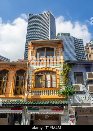 DUO office towers over Arab Street traditional shophouses fabric shops Kampong Glam Singapore. - Stock Photo