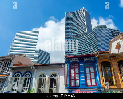 DUO and Gateway office towers over Arab Street traditional shophouses fabric shops Kampong Glam Singapore. - Stock Photo