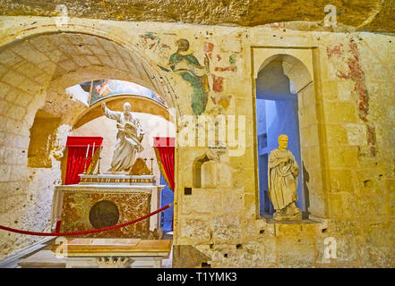 RABAT, MALTA - JUNE 16, 2018: The altar with St Paul's statue in chapel of St Paul Grotto, connected with Wignacourt museum, on June 16 in Rabat. - Stock Photo