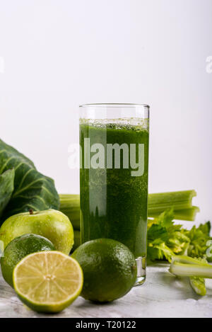 Healthy green smoothie with straw in a jar mug on white background. Copy space - Stock Photo
