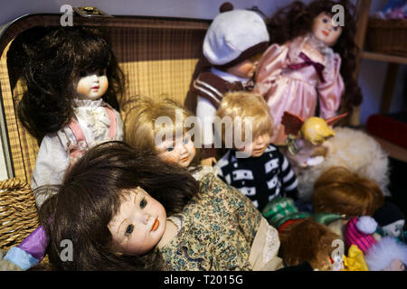 Antique bisque dolls in a retro luggage - Stock Photo