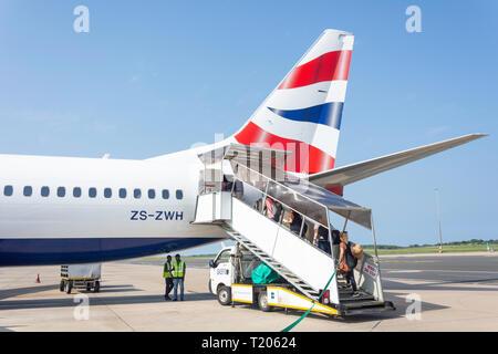 Passengers boarding Comair Boeing (British Airways) 737 aircraft at King Shaka International Airport (Durban), La Mercy, KwaZulu-Natal, South Africa - Stock Photo