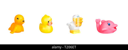 Four funny rubber bath toys isolated on a white background - Stock Photo