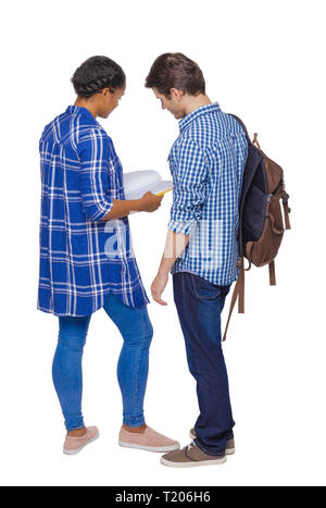 Back view of a multinational couple of students who are looking into a notebook. Rear view people collection. backside view of person. Isolated over w - Stock Photo